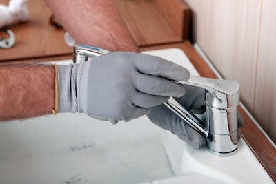 Plumber installing a faucet in Gresham OR